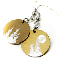 Round earrings in gold with trees and a moon.