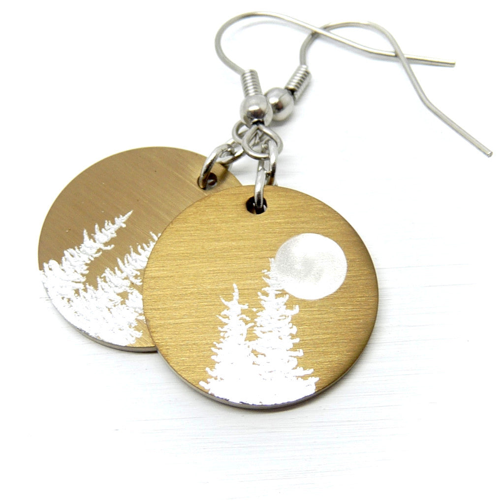 Gold earrings with silver trees and a full moon.