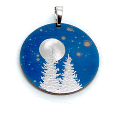 Silver trees and full moon on a blue circle pendant necklace.