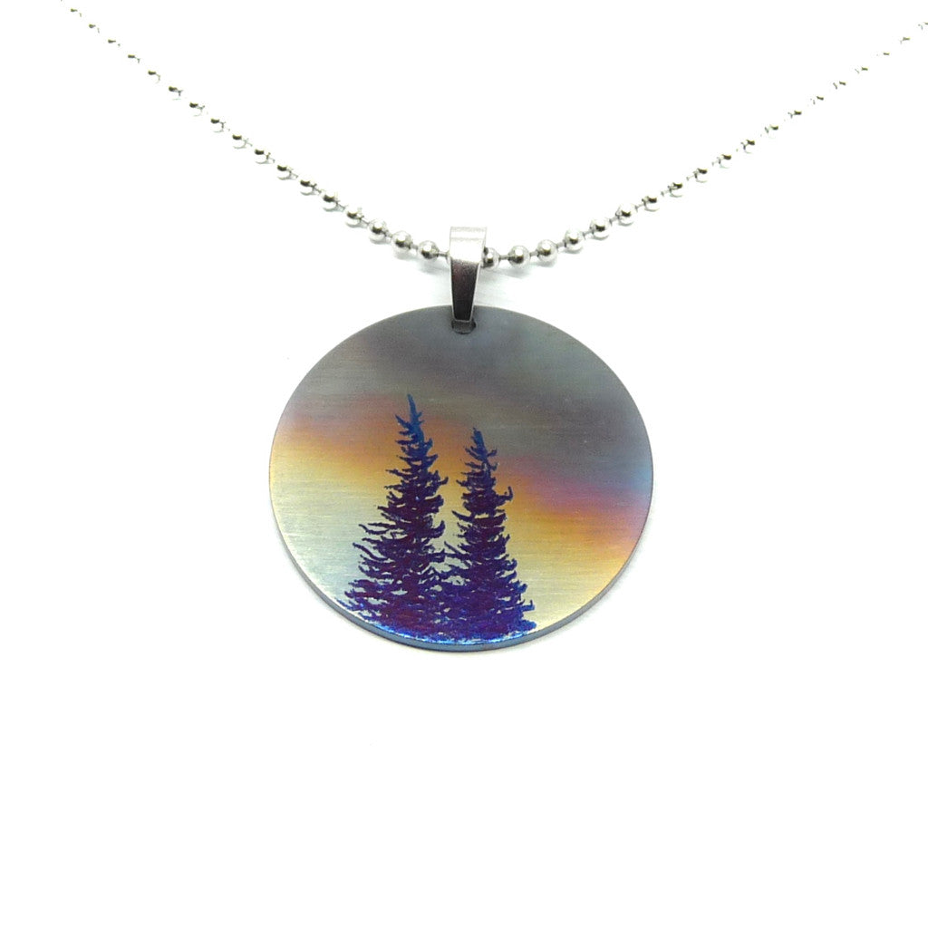 Stormy sky circle pendant with blue trees.