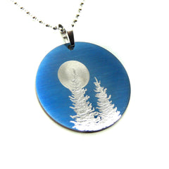 Circle necklace pendant blue sky trees and full moon.