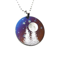 Circle pendant purple and blue with two trees and a full moon.