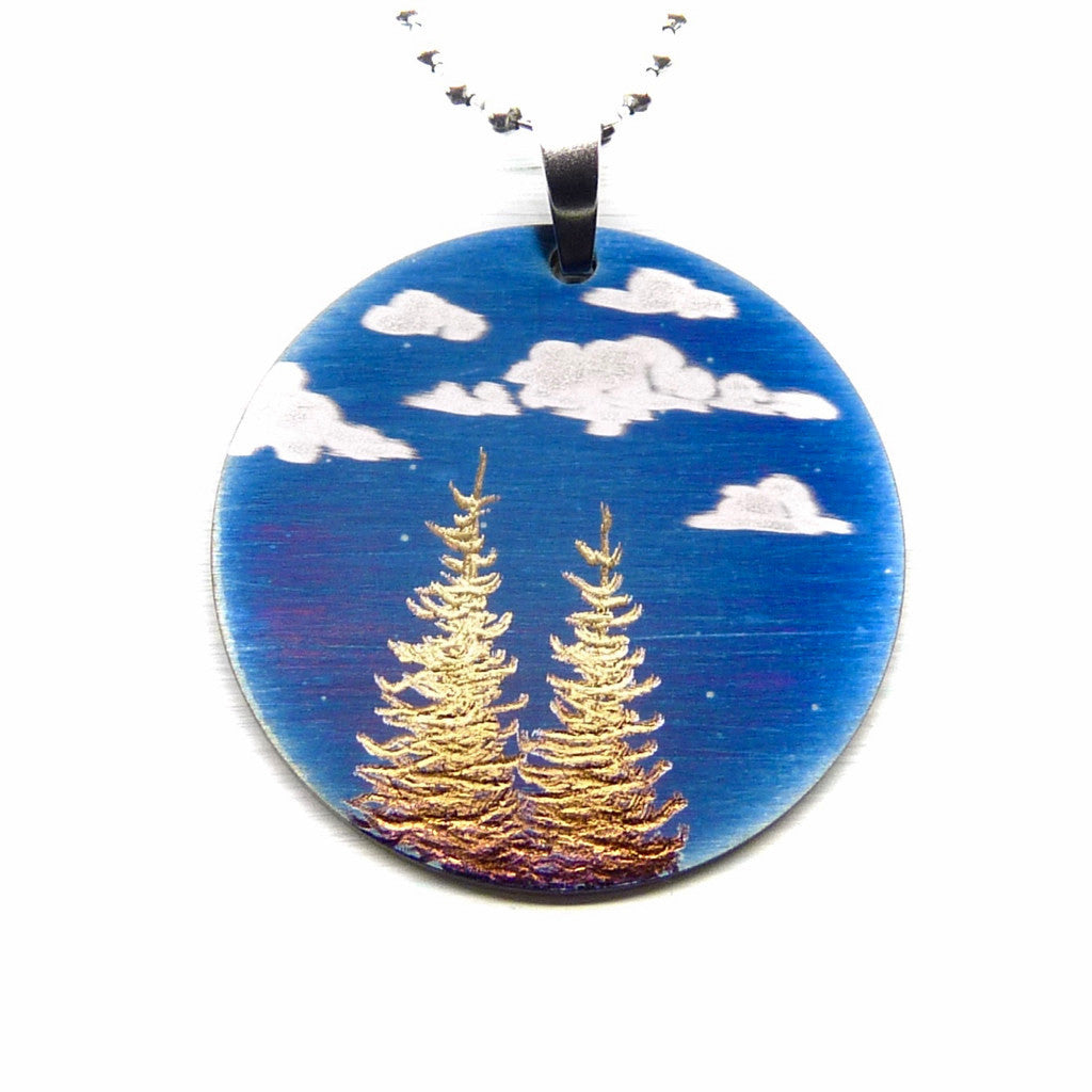 Round necklace blue sky with clouds and two gold larch trees.