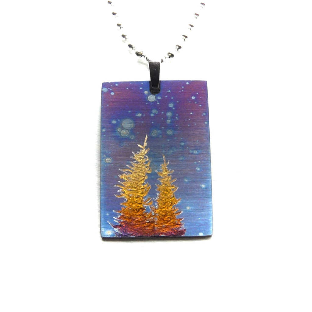Rectangle necklace with blue cosmic sky and gold trees.