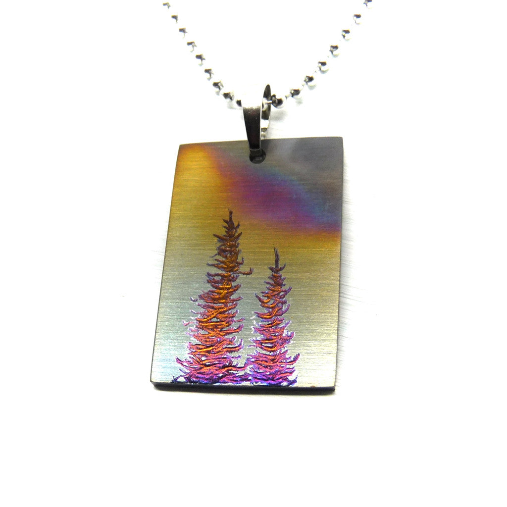 Rectangle pendant with stormy sky and two colourful trees.