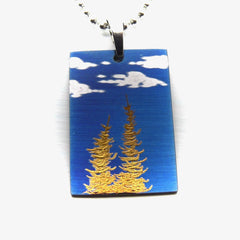 Two gold trees,blue sky and clouds on rectangle pendant.