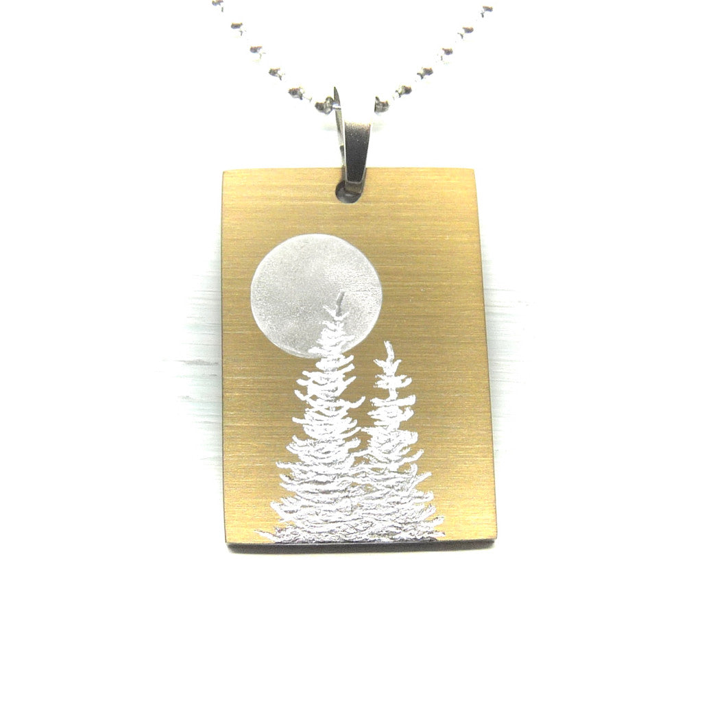 Gold rectangle necklace with trees and full moon.