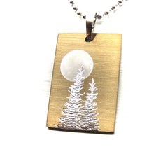 Full moon and trees on rectangle pendant.