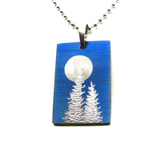Blue rectangle necklace with trees and full moon.