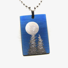 Blue rectangle necklace with two trees and moon.