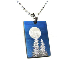 Blue rectangle pendant with full moon and trees.