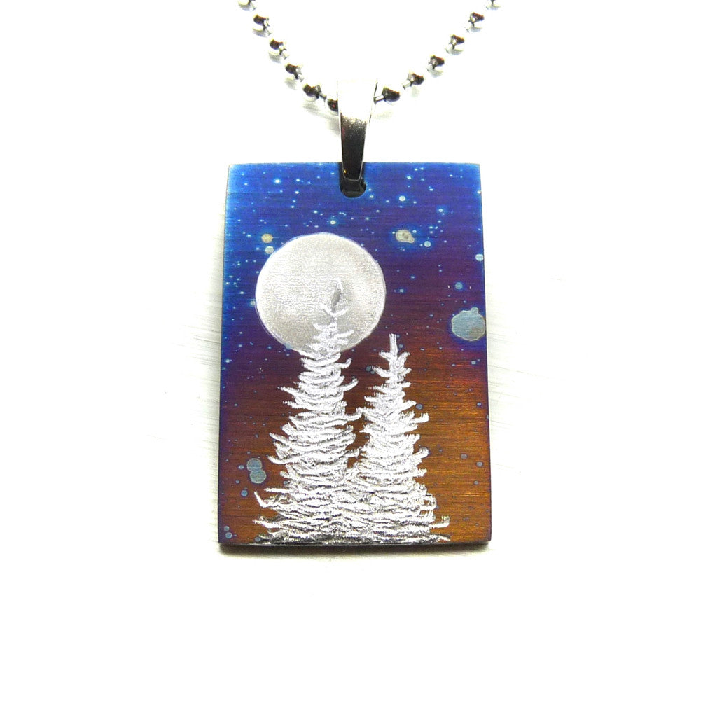 Blue rectangle necklace with two trees and full moon.