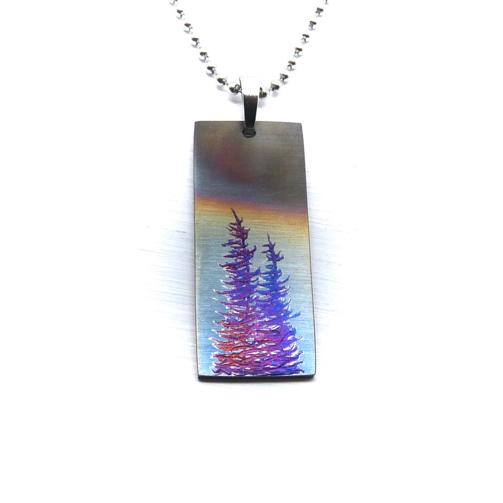 Vertical bar necklace with stormy sky and trees.