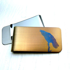 Gold money clip with blue raven on a snag. Front and back.