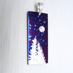 two trees and the full moon on a blue vertical bar pendant