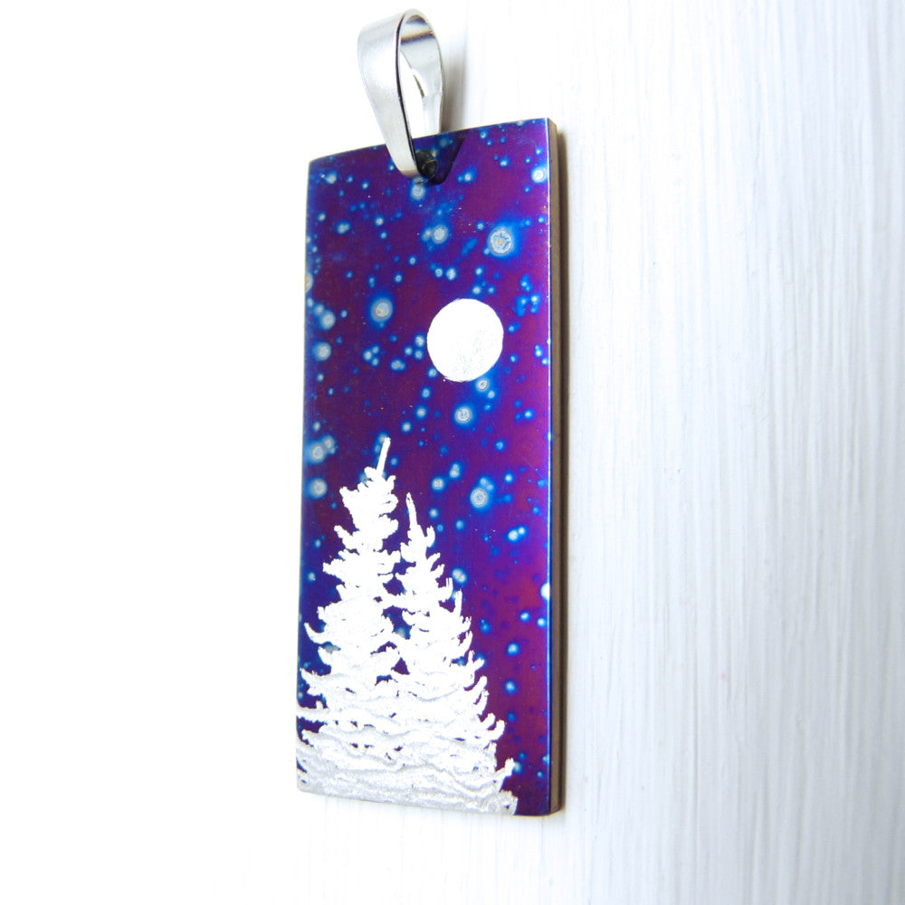 purple pendant with blue stars, silver trees and the full moon