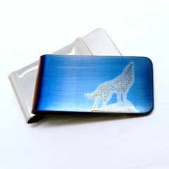 Howling wolf silhouette on a blue money clip. Front and Back.