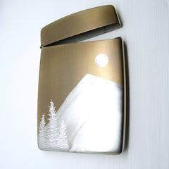 gold card case with silver trees, full moon and mountain
