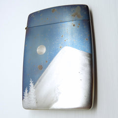 blue speckled card case with silver trees, mountain and full moon