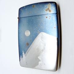 Cigarette case with mountain landscape.