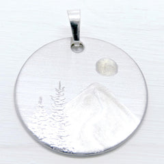 Silver mountain necklace with full moon and trees.