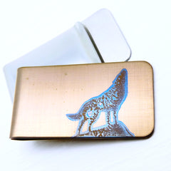 Gold money clip with howling wolf silhouette. Front and Back views.