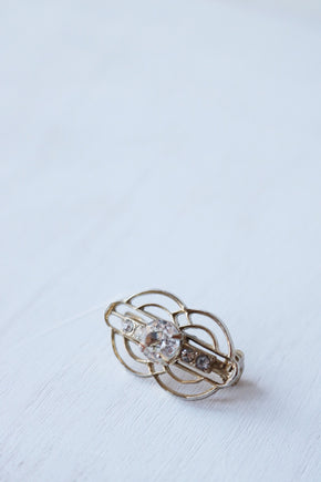 gold art deco pin