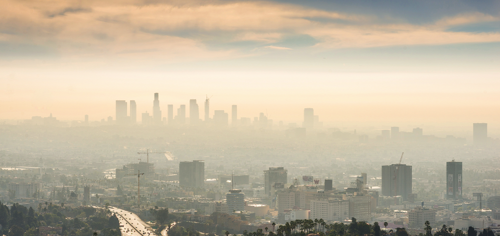 a smoggy downtown city causing chronic stress