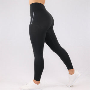 Womens classic high waisted gym leggings in black, side view