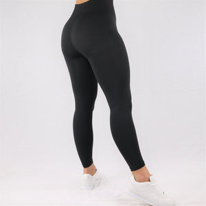 Womens classic high waisted gym leggings in black, rear view