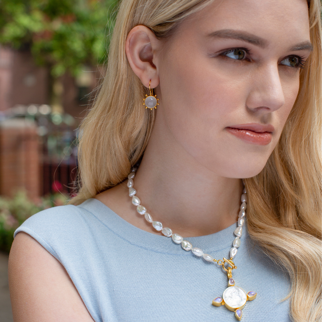 Model wearing Dina Mackney Italian Glass necklace and earrings