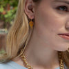 Model wearing Italian Glass and Mandarin Garnet Middie Earrings