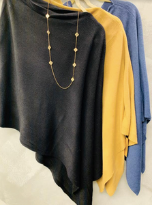 Soft wrap with in elongated side- comes in 3 solid colors black, blue, camel - goes with anything! - Juli & Boutique