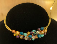 Load image into Gallery viewer, turquoise, purple, silver and gold guitar string bangle bracelet
