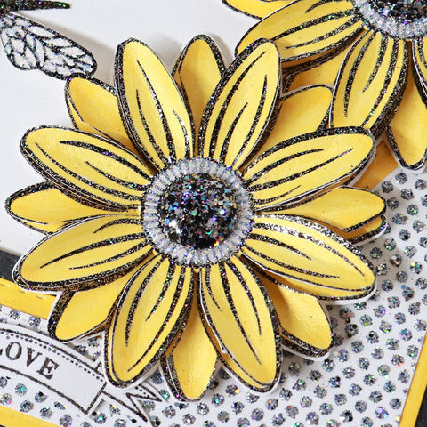 Close up of yellow handmade sunflower paper flower