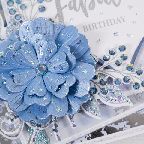 Have you been asking yourself 'How do you make cards at home?'  Well this simple and easy card making tutorial will show you how. Using essential card making products from Chloes Creative Cards. Create this beautiful blue and silver Happy Birthday card. This tutorial shows you how to create a beautiful 3D floral card. Learn how to emboss. Learn how to use cutting dies.