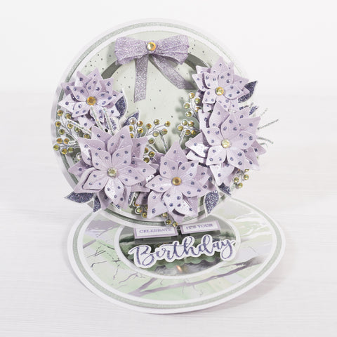 Lavender Sparkelicious onto the top, die cut the outer piece to this set in white and mat and layer both together and secure in place with foam pads.