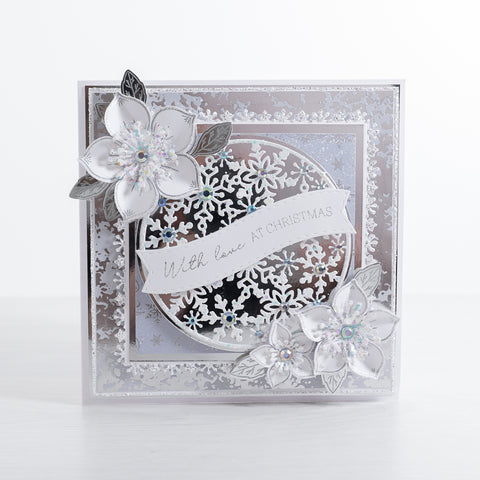 Learn how to create this magical silver snowflake Christmas card using our silver mirror card layered with our Snowflake Circle and Christmas Rose Stamps.