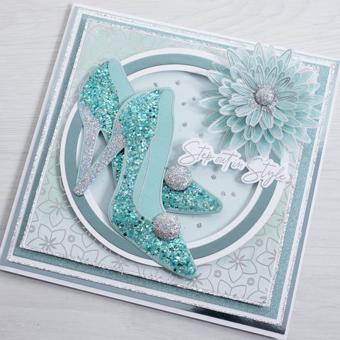 Learn how to make this beautiful blue and teal sparkling stiletto greetings card with this simple and easy tutorial from Chloes Creative Cards.