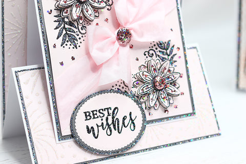 side view of pink handmade birthday card with pink flowers, ribbon and glitter embellishments