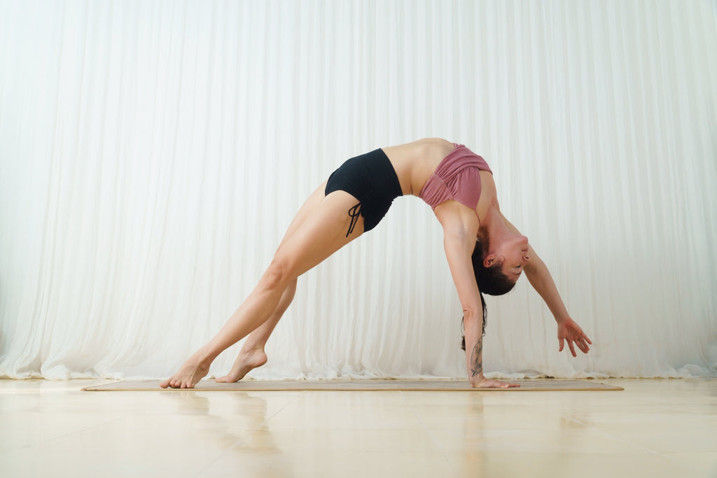 Meghan Currie, the founder of sustainable yoga clothes brand Isabelle Moon, mid action.