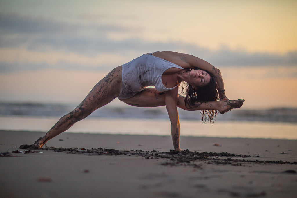 Meghan Currie doing yoga. She is the founder of Isabelle Moon, a yoga clothing brand that provides sustainable yoga clothes.