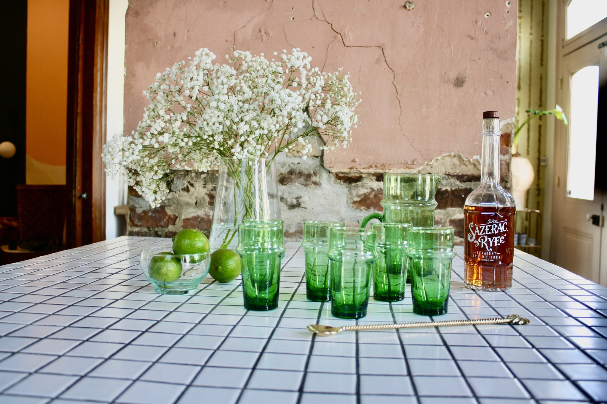 Set of 8 green handblown glasses & 1 matching pitcher handmade in Morocco from recycled glass by artisans using traditional techniques since 1946.