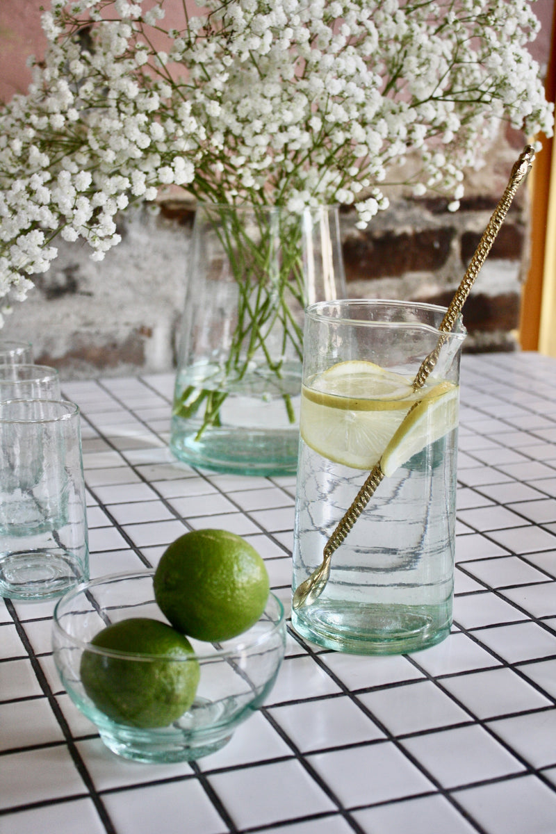 Set of 12 handblown cocktail glasses and 1 pitcher handmade in Morocco from recycled glass by artisans using traditional techniques since 1946.