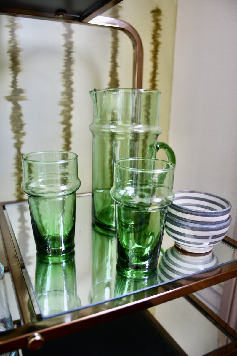Set of 12 green handblown glasses handmade in Morocco from recycled glass by artisans using traditional techniques since 1946.