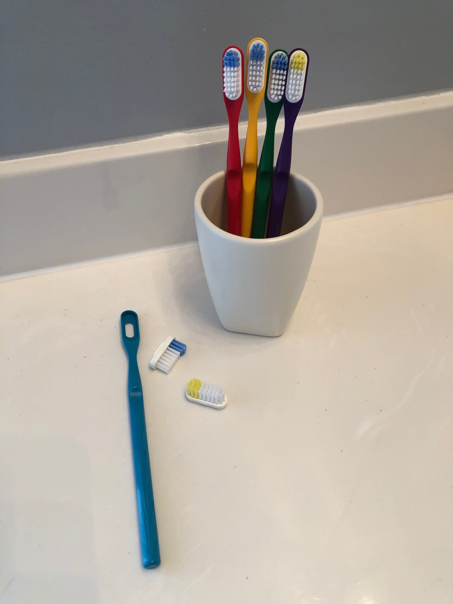 Toothbrush with replaceable-head