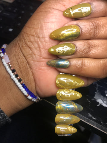 petite almond nails in olive green color, with gold flakes and glittery gold cat eye polish.