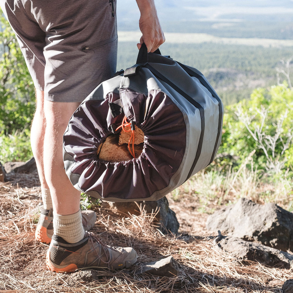 Whether you're camping, surfing at the beach, or traveling in an RV, a campfire can be essential to enjoying the great outdoors, but hauling firewood is messy.  The WoodGaiter is weatherproof, keeping the contents dry, secure and the mess contained.  Outdoor firewood sling, bag, tote.