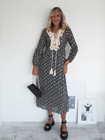 Irena front dress with black silver and white print