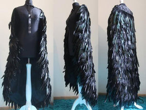 Feathered  cape and open back dress